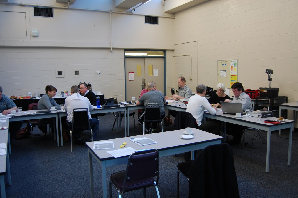 Image of Instructors at tables