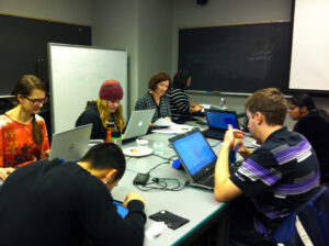 Group of students user testing the open textbooks.